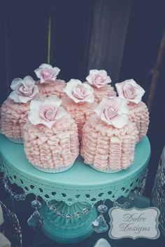 mini cakes at a mint and pink dessert table. #mint #pink #desserttable #minicakes #ruffle #cake