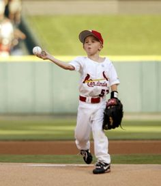 Wednesday 26 June, 2002 -- Kannon Kile, Darryl Kile's five-year-old son throws out the first pitch during a game between the St. Louis Cardinals and the Milwaukee Brewers at Busch Stadium in St. Louis, Mo.  POST-DISPATCH PHOTO BY CHRIS LEE