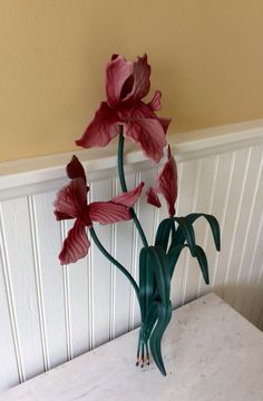Beautiful three stem iris metal wall sculpture. Done in dark pink & light pink with green leaves. Built in hook on back for hanging. In excellent vintage condition! Great for spring decor, wedding decor, porch decor, front door decor, bedroom, or bathroom. Would make a wonderful gift for Mothers Day, Valentines Day, or for anyone who loves gardening! Measures 18.25 height x 8 wide x 4.25 wall depth Thanks for shopping YellowHouseDecor!  Several metal wall sculptures sold separately in shop