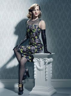 Emma Watson looking glamorous in a gorgeous dress, high heels and sheer pantyhose.