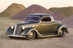 Hot Rod - guessing '36 Chevy 3 window coupe.....
