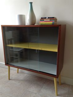 An office cabinet receives an up-lifting with 'new' vintage legs and painting.