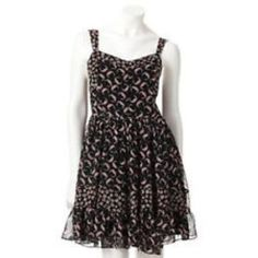 """Lc Lauren Conrad Dress NWOT. Never Worn! Very cute feminine and chic! This lovely dress features two different types of floral prints a regular floral print on the straps and lines on the bodice and on the central panel of the skirt. A flower ring print on bodice and and ruffle hem of skirt. Includes side hidden zipper for easy wear. ❗️Please - No Trades, PayPay, Holds, or Modeling  ✔Reasonable Offers Considered When Submitted Using The blue """"Offer"""" button. LC Lauren Conrad Dresses Mini"""