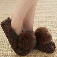 There's no need to go out and buy new slippers when you can just make your own. These cozy little knit slippers will not only look utterly adorable as you move around the house but also keep your feet warm and comfortable.