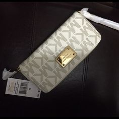 NWT Michael Kors Large Vanilla MK logo wallet New with tags. Price is firm. Not taking offers. Brand new with tags Michael Kors Bags Wallets