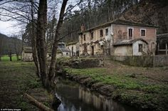 """""""The village of Barrerios, near Pontevena is just one of 2,900 villages which lie abandoned in rural Spain and are being sold off"""""""
