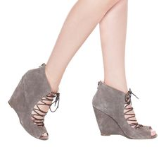 A playful lace-up front and sexy peep-toe wedge