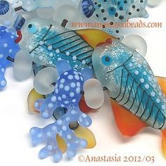 I love these fish and coral beads, and what looks like white sea glass /water bubbles. Gorgeous!