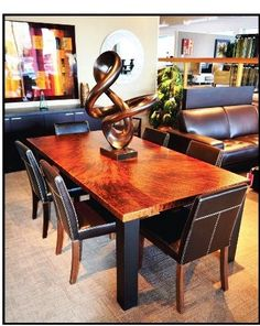 copper dining table with leather upholstered chairs with thick white stitching from beckmans fine furnishing in - Copper Kitchen Table