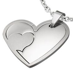 Un cadou special pentru persoana iubita. Pandantiv din otel inoxidabil format din doua inimi decupate. Trebuie doar sa le suprapui si inima se va intregi.