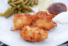 Crispy Coconut Chicken - This simple dish is gluten free and packed with flavor. Crispy coconut coated chicken nuggets, strips or breasts is a winner with all family members and will be requested again and again!