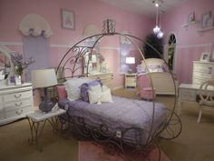 """You'll love watching your kids play in this beautiful """"sleeping coach"""" as much as they'll love sleeping in it!"""
