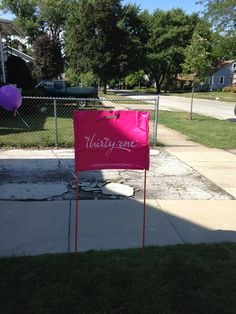 This seems simple enough. Open House sign: two post, a Thirty-One Bag, and some a balloons :)