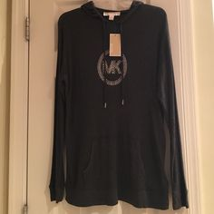 NWT Michael Kors Lightweight Hooded Pullover NWT Michael Kors Lightweight Hooded Pullover.  Pocket opening on front -- just like a sweatshirt. Charcoal gray w/ silver MK logo bling. Size M. Loose fitting. Michael Kors Tops