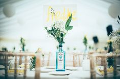 Gin Bottle Flowers Centrepiece Decor Meadow Marquee Home Made Wedding http://www.faircloughphotography.co.uk/