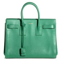 This is an authentic YSL YVES SAINT LAURENT Calfskin Small Sac De Jour in Mint. This stylish tote is crafted of beautifully grained calfskin leather in bright green. The bag features rolled leather top handles and side resin straps that when released expand the width of the bag. The top opens to a partitioned suede interior with room for all of your daily needs with the chic style only from Yves Saint Laurent!