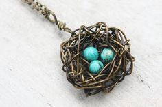 Antique Brass with Turquoise Birds Nest   https://www.etsy.com/listing/88109251/antique-brass-birds-nest-necklace-with