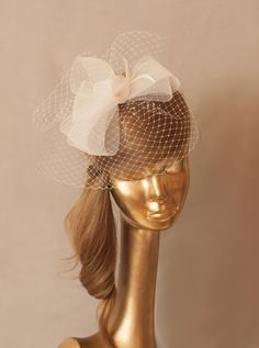 Ivory BIRDCAGE VEIL . Bridal FASCINATOR with Crin  Can be mounted on a comb or clip.  It is very comfortable and easy to wear.  Also theres a