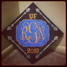 sparkly Orange and Blue graduation cap decorated mortar board decoration idea