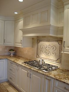 backsplash (Travertine floor ideas) plus love the counters! Different color cabinets and different handles...