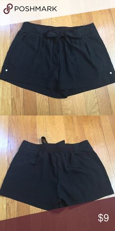 Miss Tina black shorts Elastic waistband. Decorative tie in front. Pockets on front. Lightweight, polyester. Miss Tina Shorts