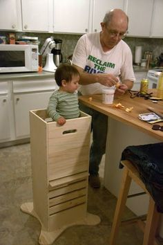 """Adjustable """"Fun Pod"""" allows toddlers to see what is happening at counter height without risk of falling off stool. Good idea!"""