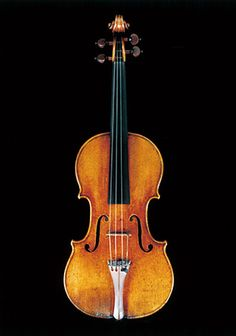 """Stradivarius 1714 Violin Dolphin This violin is recognized as one of the top three violins made by Stradivari along with the 1715 """"Alard"""" and the 1716 """"Messiah"""". This instrument was once owned and played by the world famous virtuoso Jascha Heifetz (1901-1987)."""