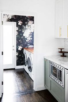 Find stylish examples of black accent walls perfect for a wall in your home that is tough to style. Domino shares photos of black accent walls to try in your home. Small Rooms, Small Spaces, Fee Du Logis, Black Accent Walls, Laundry Room Storage, Laundry Rooms, Small Laundry, Basement Laundry, Laundry Area