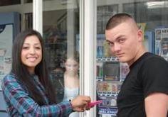 April Fools: The 10 Best Photobombs: The Lurker A couple outside a store with a lurker