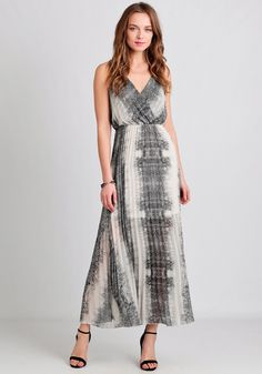 This stunning light-taupe chiffon maxi features an intricate abstract-print in a gray hue with twisted shoulder straps.
