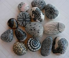 doodle designs on to stones with a Sharpie.