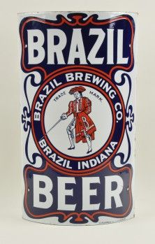 Single sided curved porcelain corner sign for Brazil Beer by the Brazil Brewing Co of Brazil Indiana. This brewery is only listed as operating from 1901-1907 so for a short lived brewery this sign has great graphics. This incredible piece has fantastic colors with top notch central vignette of a swordsman who has B.B.Co. lettered on his uniform and art nouveau style curved borders.
