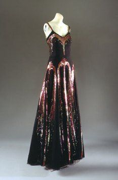 """""""Evening Dress,"""" 1938. Gabrielle (""""Coco"""") Chanel. Black Silk Net with Polychrome Sequins. The Metropolitan Museum of Art, New York. Special Exhibit: """"Blithe Spirit: The Windsor Set"""" Decoration of sequined fireworks on this evening dress."""