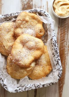 Fry Bread with Cinnamon Honey Butter...Soft and golden fried bread served hot with powdered sugar and cinnamon honey butter!!