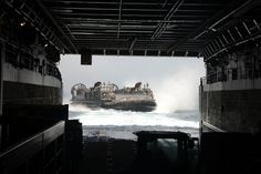 ARABIAN SEA (March 23, 2014) Landing Craft Air Cushion (LCAC) 71 prepares to enter the well deck of the amphibious transport dock ship USS Mesa Verde (LPD 19). Mesa Verde is a part of the Bataan Amphibious Ready Group and, with the embarked 22nd Marine Expeditionary Unit, is deployed in support of maritime security operations and theater security cooperation efforts in the U.S. 5th Fleet area of responsibility. (U.S. Navy photo by Seaman Phylicia A. Hanson/Released)