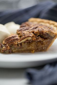 Nutty, crispy, and with a caramelized center, this quick and easy Pecan Pie Recipe is a perfect addition to any Thanksgiving table. Pecan Pie is a classic holiday dessert that doesn't include pumpkin or apples! The balance of nutty pecan flavor with the caramelized center is all held together by delicious buttery pie crust. Perfect for your Christmas dessert spread! #Christmas #pecanpie #pie #recipe #easy Easy Pie Recipes, Best Dessert Recipes, Fun Desserts, Holiday Recipes, Holiday Ideas, Breakfast Recipes, Pumpkin Pecan Cobbler, Pecan Pies, Best Pecan Pie Recipe