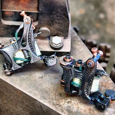 tattoo machines: Aaron Cain meched-out one-offs carved and built with Seth Ciferri Owen liner and shader frames