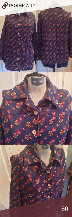 """•VTG• Floral Lightweight Jacket 💐 This lightweight jacket is perfect for the spring season! Heathered navy blue with an orange underside with yellow orange and red daisy pattern. Excellent Vintage Condition. Cute wood Buttons. Two roomy pockets on the front. Stretchy cotton poly blend perhaps. No tag and no label. Sleeves each have a wood button too. Cute! Measurements Taken Flat ✂️️ Bust 18"""" Sleeve 21"""" Length 26"""". I only source quality vintage pieces. Thanks for shopping my closet! Vintage…"""