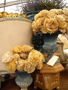 beautiful urns with paper flowers made out of vintage dress patterns. could be fun to try to make.