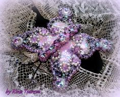 hand embroidery with pearls, sequins, Japanese beads, Swarovski crystals. Embroidery on silk organza natural