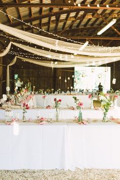 For a laid-back, rustic wedding that will really wow your guests, consider this wedding-on-the-farm inspiration. Gorgeous exposed wood and earthy vibes make for a lovely backdrop for a pretty pink and gold event. String lights and plenty of fresh flower centerpieces will really make your tables come to life!