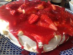 Delicious pav with strawberry vodka coulis by #emsmith
