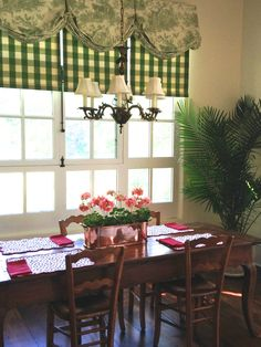 Antique French table and chairs with window treatments in a green and white toile and check combination at danceofdestiny.com