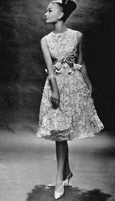 Model wearing a pink lace dress by Christian Dior, 1962. Photo by Georges Saad.