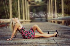 Senior picture on a bridge. Makes for an AMAZING picture. It helps when you have a gorgeous model!!!! www.facebook.com/hillsidedesigns
