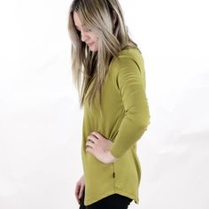 Women's Long Sleeve Henley| Light Green Our moss green is aperfect earth tone for your fall/winter wardrobe. Introducing our new Women's Long Sleeve Henley Shirt! This new style features a scoop hem in an extra long length that makes it a perfect pairing for leggings! Your new, go-to cozy outfit! Details: Fabric - Women's Henley, Henley Shirts, Long Sleeve Henley, Winter Wardrobe, New Woman, Fall Winter, Cozy, Earth, Leggings