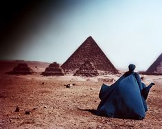 Angle of Repose Models: Anzhelika Kocheva at Marilyn and Anna De Rijk at DNA. photographed by Serge Leblon styled by Alessandra Woroniecka There is an Egyptian pyramid background.