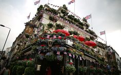 The Churchill Arms pub in Notting Hill, London, is decorated with Union Jack flags.  Picture: Peter Macdiarmid/Getty Images.  The Queen's Diamond Jubilee preparations: flags and bunting around the UK.