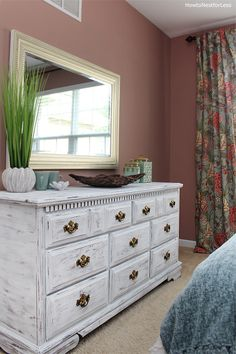 If you saw my guest bedroom makeover last week, you may have spotted my newwhite distressed dresser. Except it isn't new… it's actually really old, just with a new coat of paint. Here's what the dresser looked like before in our old house… And here it is now in all of it's white, chippy goodness. …