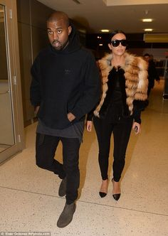 Smart... and casual: While Kim opted for a smarter ensemble, her husband Kanye West decide...